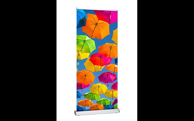 Dit is een roll-up banner met een foto van kleurrijke paraplu's.